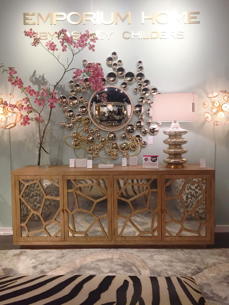 This credenza by Emporium Home with Ashley Childers can serve as a media center or storage for a family living room.   High Point Market 2015 – Most Fascinating Style Spotters' Choices Arianne Bellizaire emporium home credenza