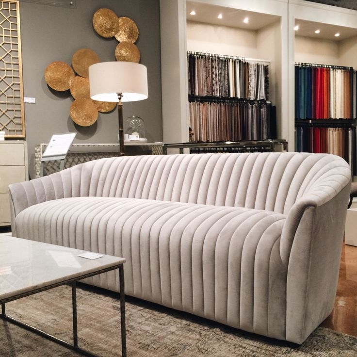 Channel Sofa at Interlude Weiman! This sexy sofa with a vintage appeal can be customized for our clients. We love those sinuous curves contrasting with the geometric lines of the channel tufting.  High Point Market 2015 – Most Fascinating Style Spotters' Choices Beth Dotolo channel sofa