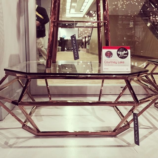 Rose gold coffee table from Sharon Ites. It's a beautiful metallic and has a strong architectural element. The geometric base is like sculpture in a room.  High Point Market 2015 – Most Fascinating Style Spotters' Choices Part 2 Courtney Lake coffee table