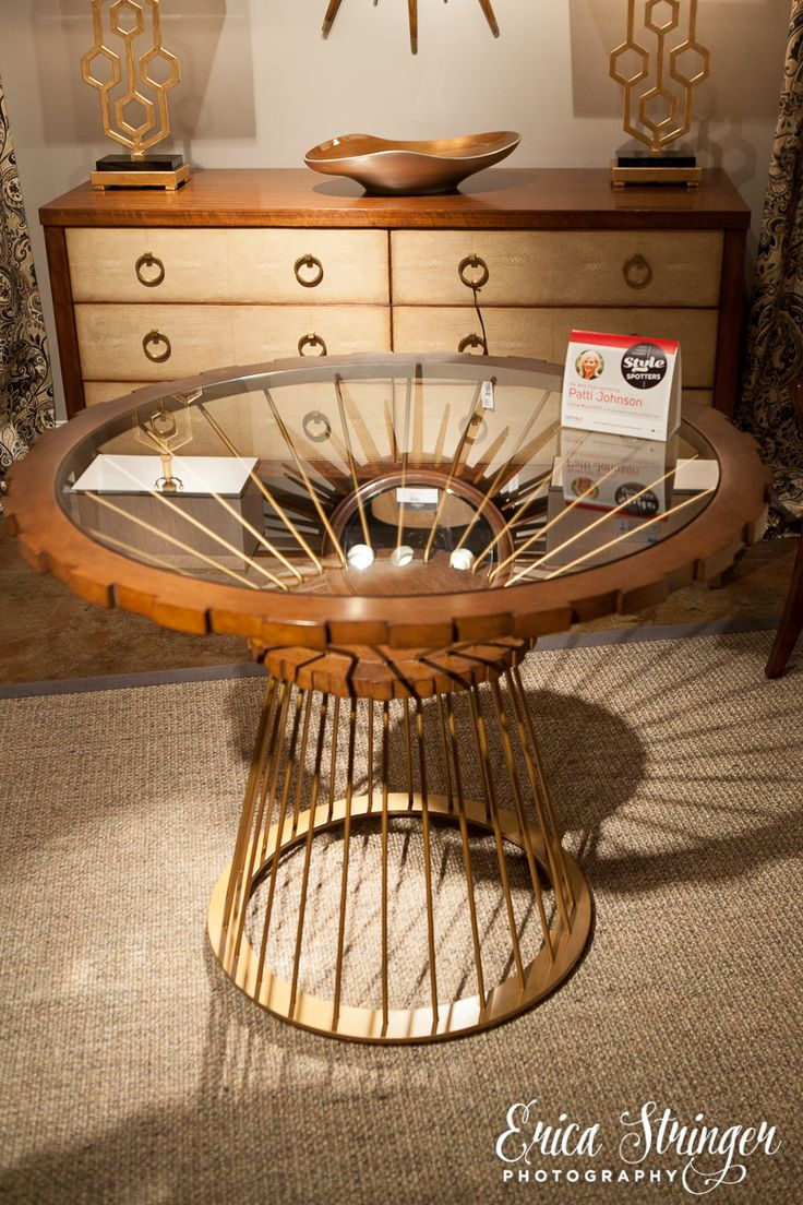Jonathan Charles Fine Furniture Foyer table. Brass bass with gear design top. Glass inlay and gear tooth edge.  High Point Market 2015 – Most Fascinating Style Spotters' Choices Part 2 Patti Johnson jonhatan charles