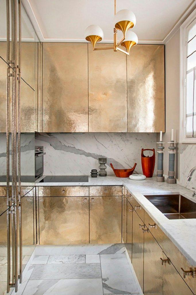 J.L. Deniot - hammered brass kitchen cabinets in the Parisian Apartment