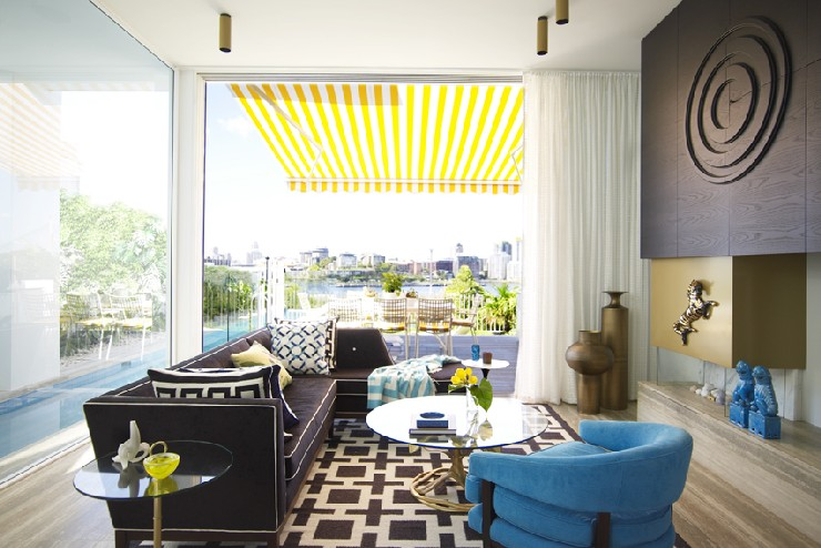 Love the pops of turquoise and yellow alongside the black and gold anchors in this living room by Greg Na  25 Best Interior Design Projects by Greg Natale 19 Love the pops of turquoise and yellow alongside the black and gold anchors in this living room by Greg Natale