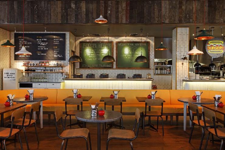 Gourmet Burger Kitchen, Stratford Dining Area by M. Brudnizki Design Studio martin brudnizki 25 Best Interior Design Projects by Martin Brudnizki 8 Gourmet Burger Kitchen Stratford Dining Area by Martin Brudnizki Design Studio