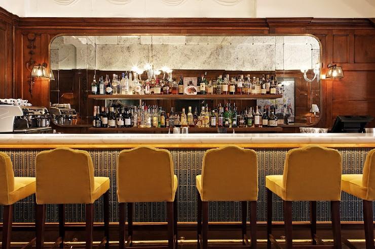Wild Honey, London yellow mohair bar stools by Martin Brudnizki Design Studio
