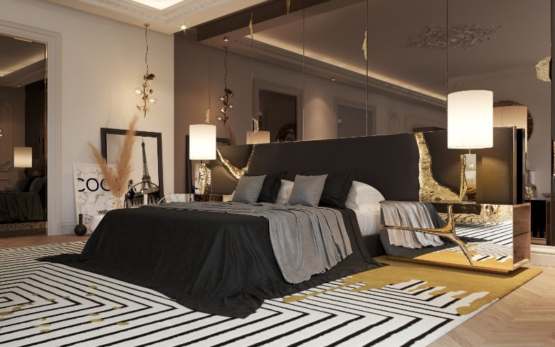 """Master Suite The Designer's Team referred that """"The Master Bedroom was mainly inspired by the art pieces that the client brings from all the corners of the world, like the vintage black mirror and the rug"""", but the centre stage it's the king-size bed. The bed is framed with the handmade Lapiaz Headboard, from Boca do Lobo 2020 Collection. This imposing design piece is inspired by the french word for 'stone' that when frizzed, cracks into an unexpected stunning interior revealing all the inside details.  paris penthouse Luxurious Paris Penthouse Designed by Boca do Lobo Luxurious Paris Penthouse Designed by Boca do Lobo 13 Alongside the rest area, the team conceived a space to rest with two armchairs and the beautiful D. Dinis Fragmented Mirror maximizing the space even more. Now joining Imperfectio family, of the Brand, is a product design for the owner's best friend, the Imperfectio Pet Bed. """"A special require from the client that we accepted a challenge to enter into the pet luxury products"""". A comfortable pet-essential piece, particularly resistant to water and scratches.  paris penthouse Luxurious Paris Penthouse Designed by Boca do Lobo Luxurious Paris Penthouse Designed by Boca do Lobo 6 The master wardrobe design has a central lounge area with two statement armchairs, covered in brass, giving the space an authentic and luxury style.  """"Glass doors show the Designer clothes collection and give the closet a feeling of bright and open space.""""  BOCA DO LOBO DESIGN STUDIO  paris penthouse Luxurious Paris Penthouse Designed by Boca do Lobo Luxurious Paris Penthouse Designed by Boca do Lobo 10 Fulfilling this elegant room, the neutral and patterned rug from the brand Rug Society, a partner in this project, works well in the interior design geometry and helps to bring warmth into the luxury closet needs.  paris penthouse Luxurious Paris Penthouse Designed by Boca do Lobo Luxurious Paris Penthouse Designed by Boca do Lobo 9 The time everyone spends in the bathroom is p"""